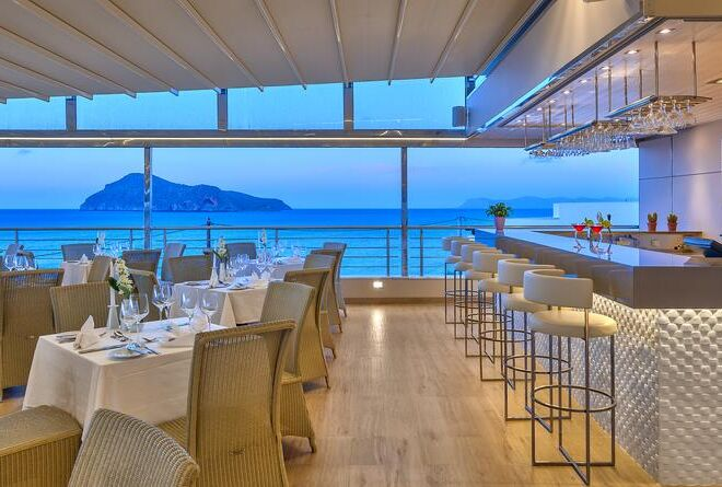 Porto Platanias Beach Resort & Spa restaurant view